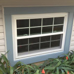 double hung basement window with grids